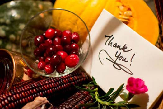hank you handwritten card in An autumn gift basket with candied cranberry, home made compote, indian corn and sweet pumpkin slice to say thank you with the warmth of the season