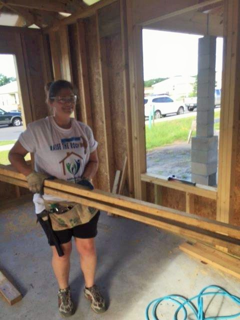 Alliant's Rachel Ryan working at Habitat for Humanity